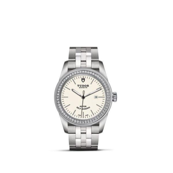 Relógio TUDOR Glamour Date com Caixa em aço, 31 mm, luneta cravejada de diamantes. Disposição vertical, fundo branco.