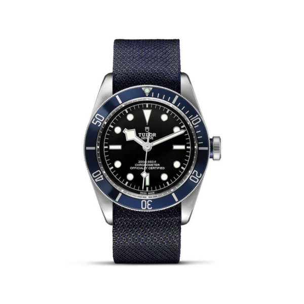 TUDOR Black Bay Watch with 41 mm steel case, blue fabric strap. In upright position, white background.