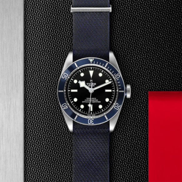 TUDOR Black Bay Watch with 41 mm steel case, blue fabric strap. In store flat lay.