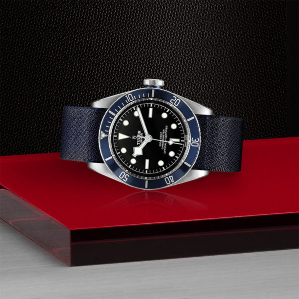 TUDOR Black Bay Watch with 41 mm steel case, blue fabric strap. In store laying down.
