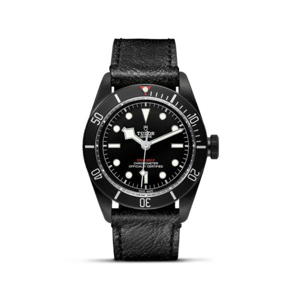 TUDOR Black Bay Dark Watch with 41 mm PVD steel case, aged leather strap. In upright position, white background.