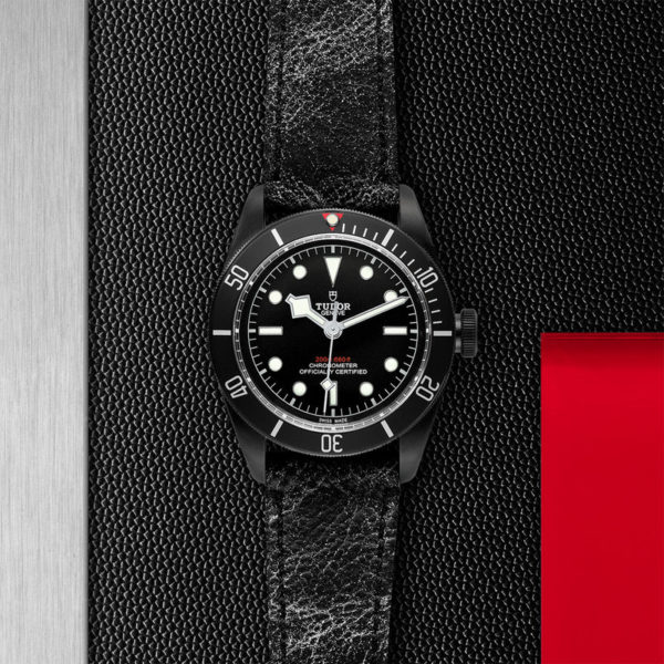 TUDOR Black Bay Dark Watch with 41 mm PVD steel case, aged leather strap. In store flat lay.