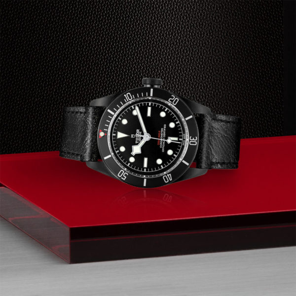 TUDOR Black Bay Dark Watch with 41 mm PVD steel case, aged leather strap. In store laying down.