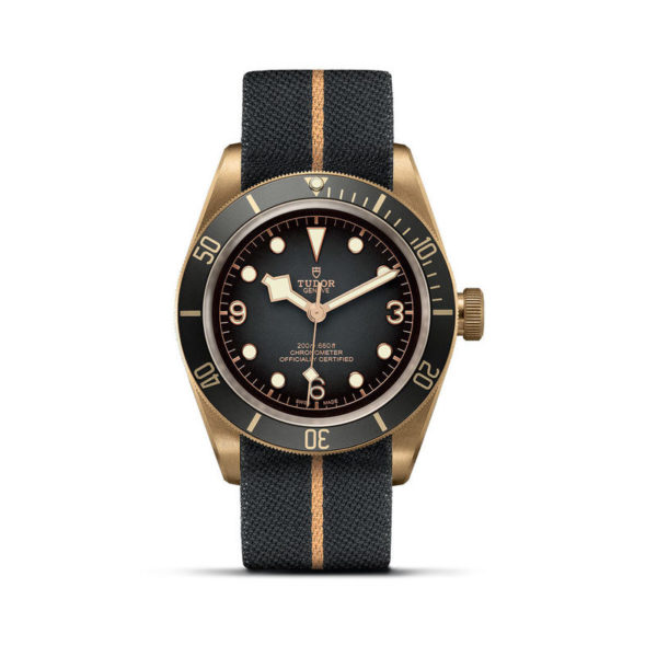 TUDOR Black Bay Bronze Watch with 43 mm bronze case, fabric strap. In upright position, white background.