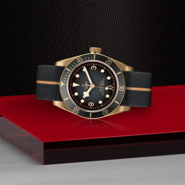 TUDOR Black Bay Bronze Watch with 43 mm bronze case, fabric strap. In store laying down.