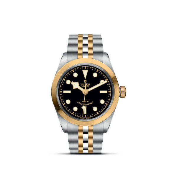 TUDOR Black Bay 36 S&G Watch with 36 mm steel case, steel and gold bracelet. In upright position, white background.