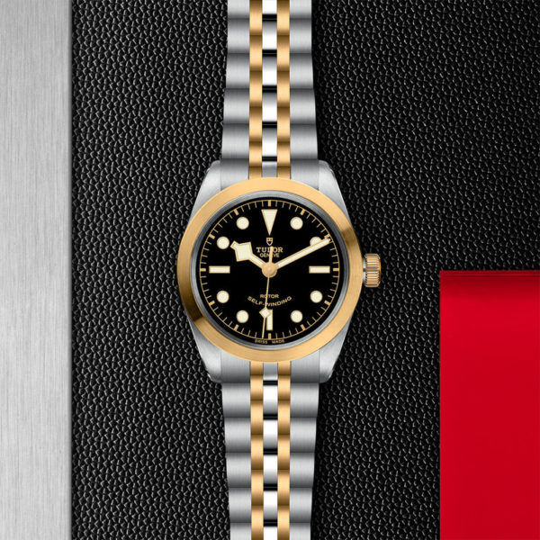 TUDOR Black Bay 36 S&G Watch with 36 mm steel case, steel and gold bracelet. In store flat lay.
