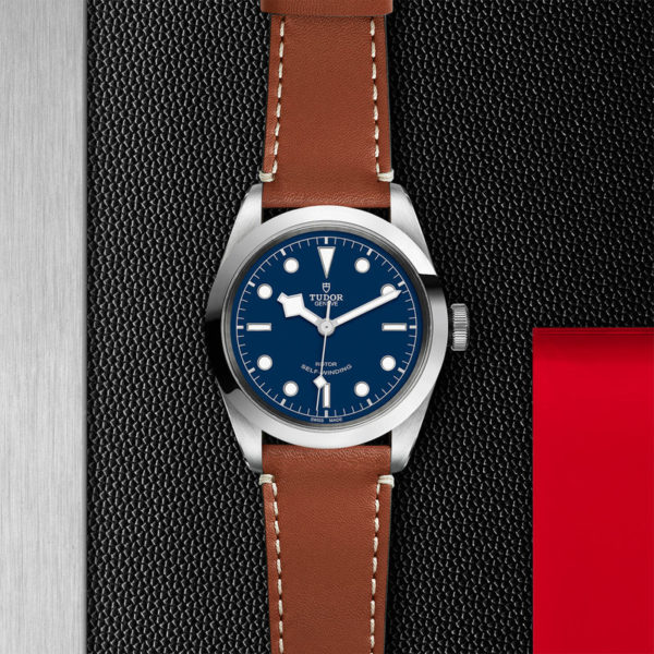 TUDOR Black Bay 41 Watch with 41 mm steel case, brown leather strap. In store flat lay.