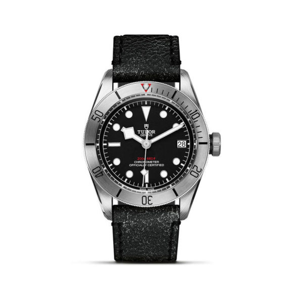 TUDOR Black Bay Steel Watch with 41 mm steel case, aged leather strap. In upright position, white background.