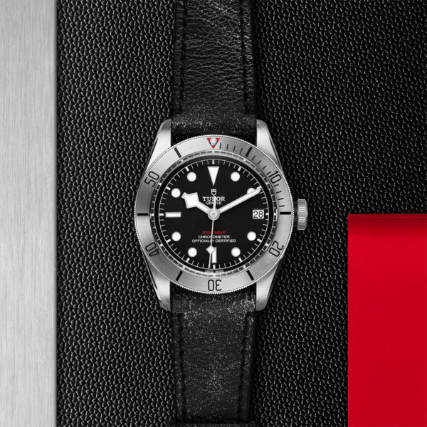 TUDOR Black Bay Steel Watch with 41 mm steel case, aged leather strap. In store flat lay.