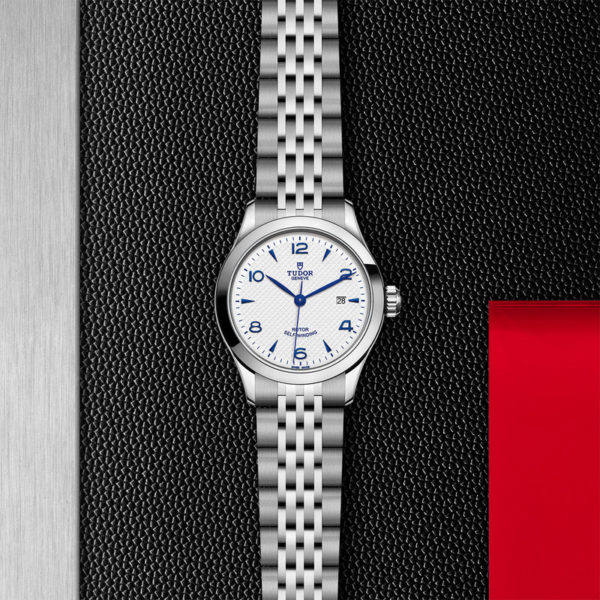 TUDOR 1926 Watch with 28 mm steel case, opaline and blue dial. In store flat lay.