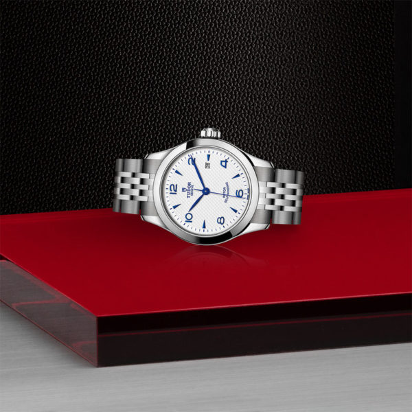 TUDOR 1926 Watch with 28 mm steel case, opaline and blue dial. In store laying down.