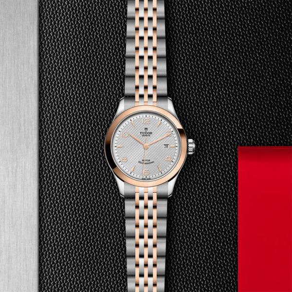 TUDOR 1926 Watch with 28 mm steel case, pink gold bezel. In store flat lay.