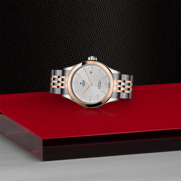 TUDOR 1926 Watch with 28 mm steel case, pink gold bezel. In store laying down.
