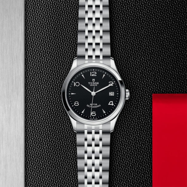 TUDOR 1926 Watch with 36 mm steel case, dark-coloured dial. In store flat lay.