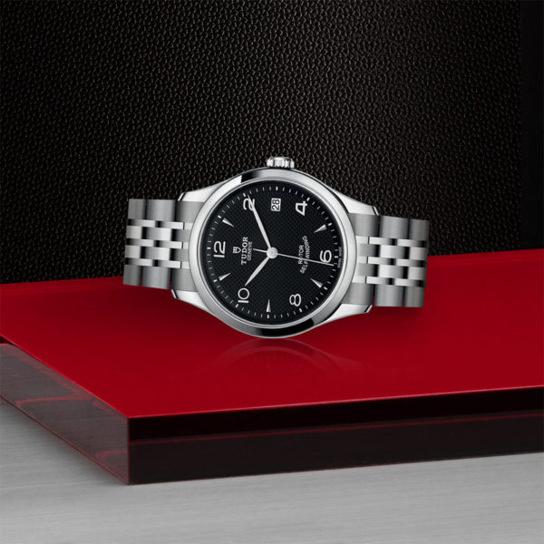 TUDOR 1926 Watch with 36 mm steel case, dark-coloured dial. In store laying down.