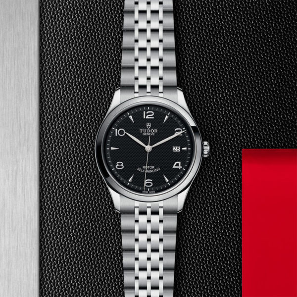 TUDOR 1926 Watch with 39 mm steel case, dark-coloured dial. In store flat lay.