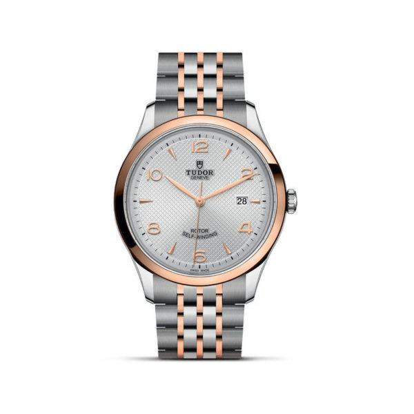 TUDOR 1926 Watch with 41 mm steel case, pink gold bezel. In upright position, white background.