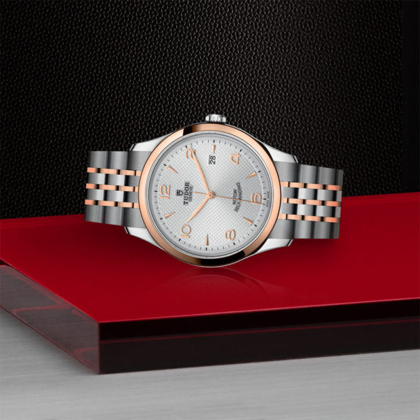 TUDOR 1926 Watch with 41 mm steel case, pink gold bezel. In store laying down.