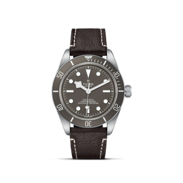 TUDOR Black Bay Fifty-Eight 925 Watch with 39 mm silver case, Brown leather bracelet. In upright position, white background.