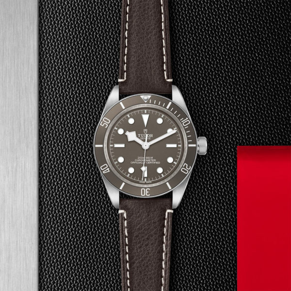 TUDOR Black Bay Fifty-Eight 925 Watch with 39 mm silver case, Brown leather bracelet. In store flat lay.
