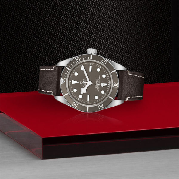 TUDOR Black Bay Fifty-Eight 925 Watch with 39 mm silver case, Brown leather bracelet. In store laying down.