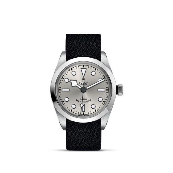TUDOR Black Bay 36 Watch with 36 mm steel case, Black fabric strap. In upright position, white background.
