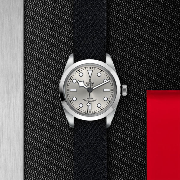 TUDOR Black Bay 36 Watch with 36 mm steel case, Black fabric strap. In store flat lay.