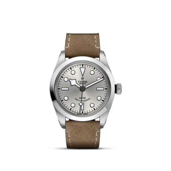 TUDOR Black Bay 36 Watch with 36 mm steel case, Beige leather strap. In upright position, white background.
