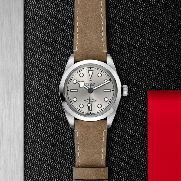 TUDOR Black Bay 36 Watch with 36 mm steel case, Beige leather strap. In store flat lay.