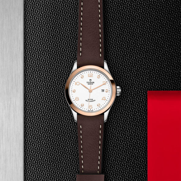 TUDOR 1926 Watch with 28 mm steel case, White diamond-set dial. In store flat lay.