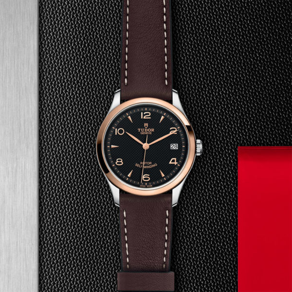 TUDOR 1926 Watch with 36 mm steel case, Pink gold bezel. In store flat lay.