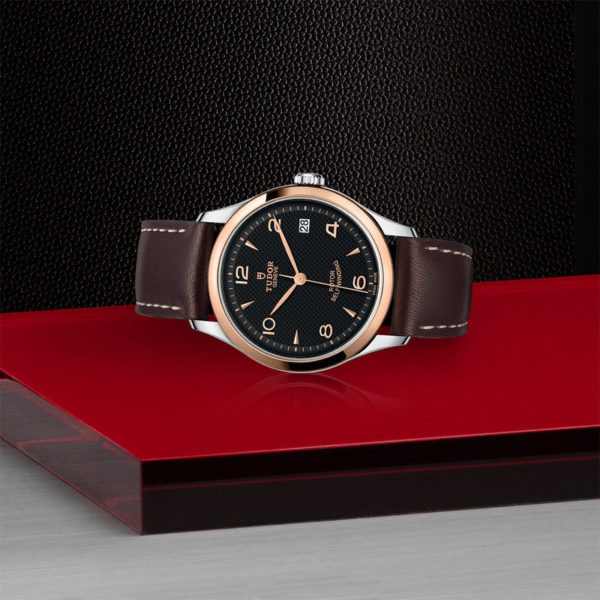 TUDOR 1926 Watch with 36 mm steel case, Pink gold bezel. In store laying down.